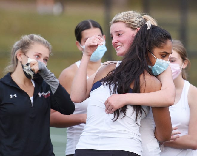 Sewickley Academy's Ashley Close is comforted by teammates after she battled for over three hours with Knoch's Brooke Bauer during the WPIAL Class AA girls tennis championship.  Bauer won the match.