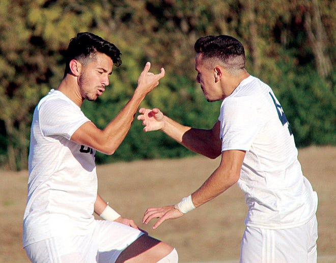 Julio Belo, left, has been a key factor to the men's soccer success the past few seasons for Oklahoma Wesleyan University.