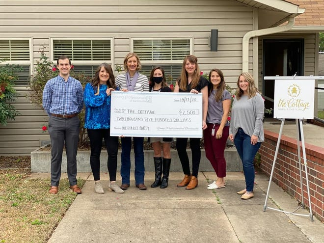 Young Professionals of Bartlesville donated sponsorship funds for their cancelled H.O.T. Street Party to The Cottage, a nonprofit organization that offers free mobile ultrasound clinics, maternal/newborn resources and residential care for pregnant women. From left are Brady Spratt, The Cottage executive director Juli Merciez, Molly Spahn, Katie Boatright, Jourdan Foran, Anna Short and Micole McKinney.