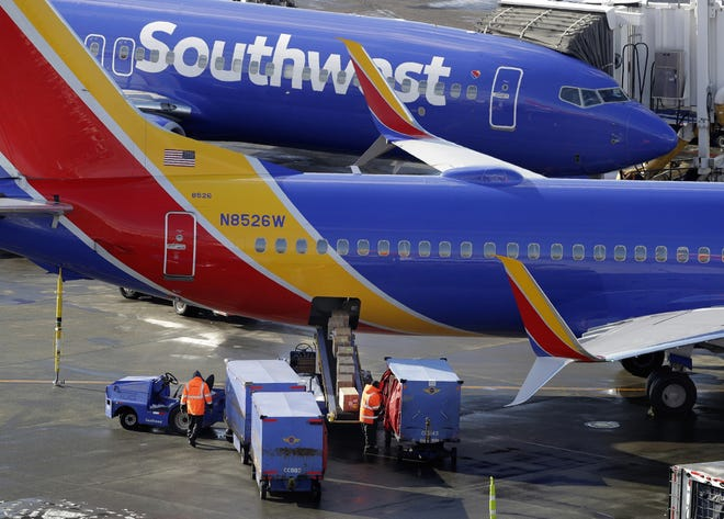 Southwest Airlines planes are loaded Feb. 5 at Seattle-Tacoma International Airport in Seattle.