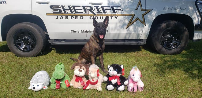 The Jasper County Sheriff's Office has partnered with PetSmart for another year to provide plush toys to children this holiday season. K-9 officer Grim is pictured with some of the plush toys that can be purchased for the program.