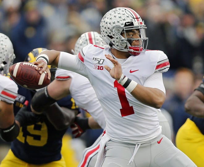 Ohio State quarterback Justin Fields throws a pass against Michigan in November in Michigan Stadium.