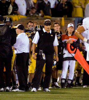 Gary Pinkel led the Tigers from 2001-15, winning five conference division titles, earning10 bowl bidsand finishingranked five times.