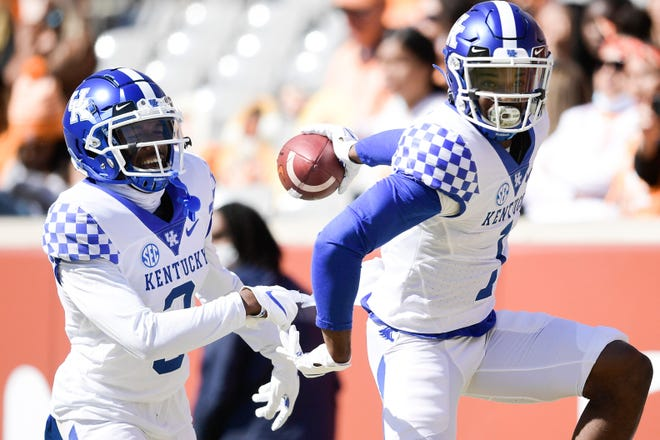 Kentucky defensive back Kelvin Joseph (1) celebrates a touchdown after making an interception during a game against Tennessee last Saturday at Neyland Stadium in Knoxville, Tenn.