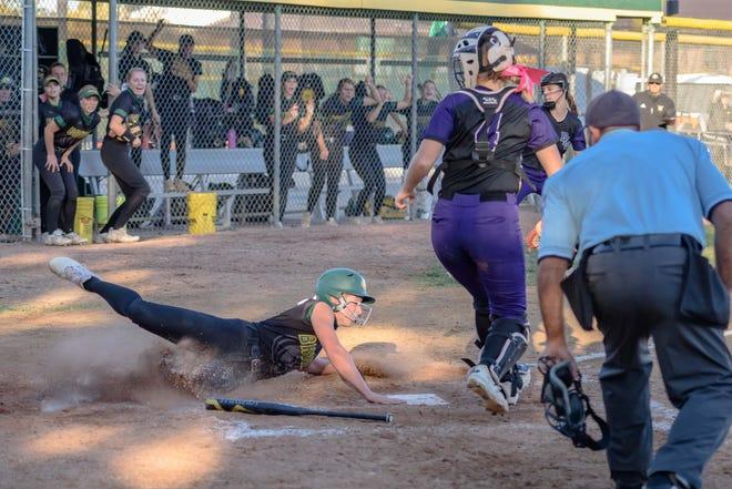 Rock Bridge's Maddie Snider (3) touches home plate for a run against Fort Zumwalt West during a Class 5 quarterfinal game Thursday at Rock Bridge High School.