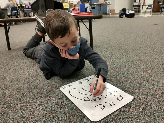 James Prendeville, 5, a kindergarten student at Wyandot Elementary School in the Dublin school district, practices his letters on a dry-erase board. Because of increasing COVID-19 cases locally and across Ohio, the school district said Friday that it would no longer be moving forward with plans it announced previously to return students to school five days a week.