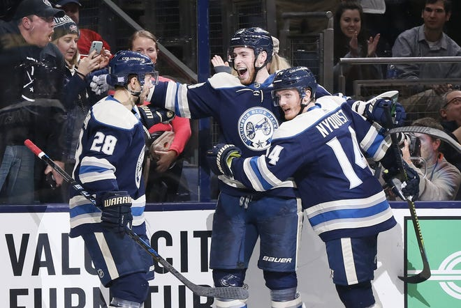 Right wing Oliver Bjorkstrand (28) and center Pierre-Luc Dubois, middle, are probably set on the Blue Jackets' top forward line. They might be joined by Gustav Nyquist, right, who had a productive first season with the team in 2019-20.