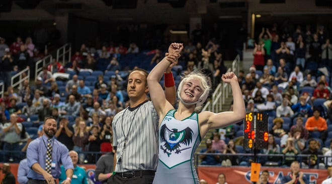 UCA's Heaven Fitch flexes after becoming the first female to win an NCHSAA Championship in the 1A 106 in the Championship match of the 2020 NCHSAA Wrestling Championship at the Greensboro Coliseum in Greensboro, NC on February 22, 2020.