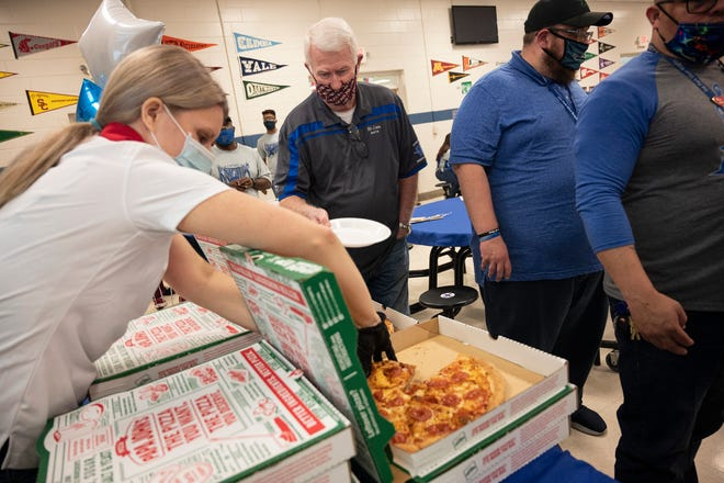 Wendy Fountain serves pizza and salad to teachers at the celebration at Oak Park Middle School in Leesburg. [Cindy Peterson/Correspondent]