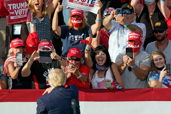 Supporters cheer at a campaign rally for President Donald Trump on Oct. 23 in The Villages, in Central Florida. Trump has so far refused to concede the election to President-elect Joe Biden.
