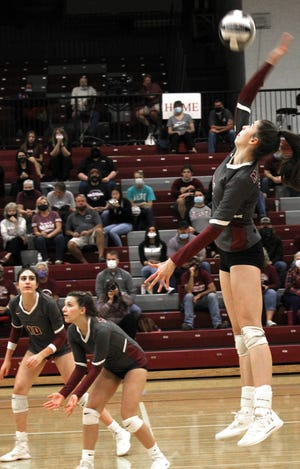 John Glenn's Abigail Walker (24) spikes the ball during OHSAA D-II Sectional volleyball action with Minerva at John Glenn High School Thursday evening.