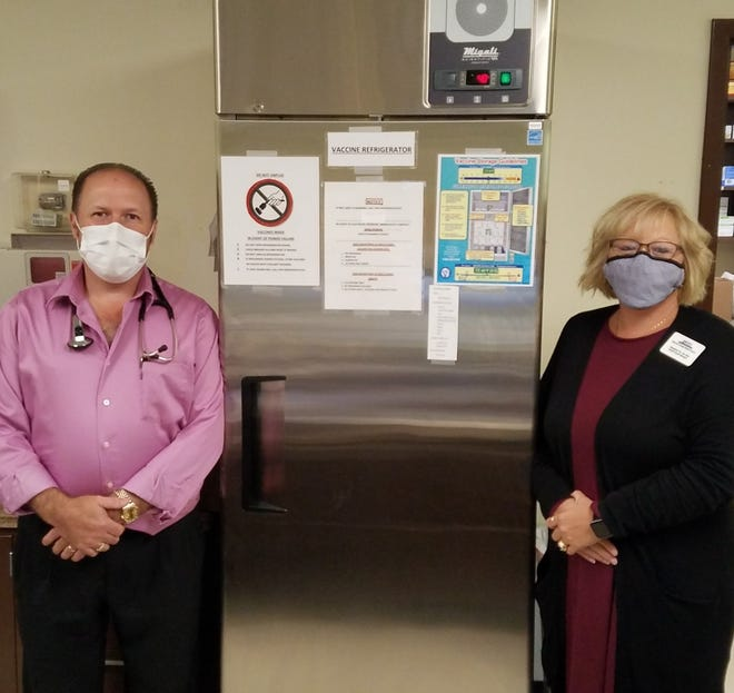 Dr. Ron Williamson and Heather Saffle, BSN, Health Center Manager both from the Monroe Family Health Center