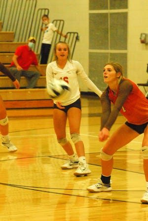 Meadowbrook's Camden Black passes the ball during Division II sectional volleyball play on Thursday evening against Zanesville.