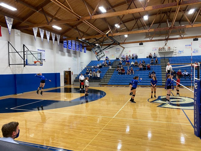 Central Christian tournament volleyball action.