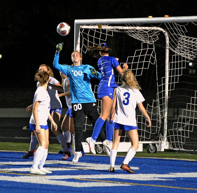 Wooster keeper Grace Kostohryz was unable to grab this corner kick which ended up with a goal for Brunswick.