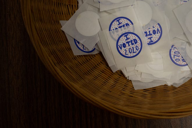 """New """"I Voted"""" stickers designed by Spring Hill High School junior Penelope Richards sit ready to pickup during early voting at the Maury County Election Commission in in Columbia, Tenn., on Thursday, Oct. 22, 2020."""