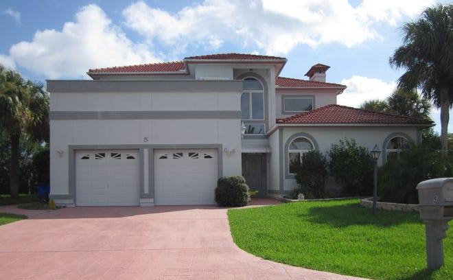 Built in 1989 on a saltwater canal in the Palm Harbor Subdivision, this house on Cleveland Court has three bedrooms and five baths in 3,444 square feet of living space. It also has a fireplace, a summer kitchen, three en-suite bedrooms, two balconies, a wet bar and a screened pool and spa. It sold recently for $450,000.