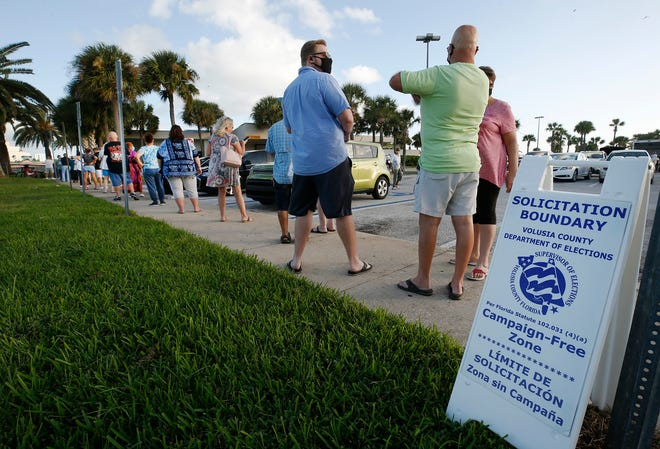 Voters line up at City Island in Daytona Beach to cast their vote on the first day of early voting.
