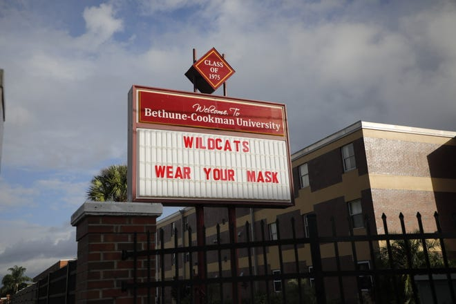 The marquee outside Bethune-Cookman University reminds students to wear masks on campus.