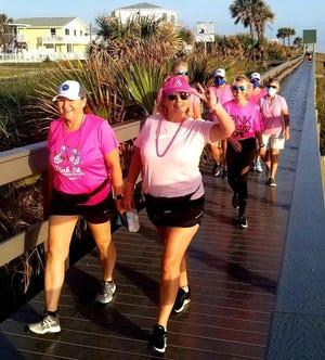 Rotary Club of Flagler Beach members walk along the boardwalk toward the Flagler Beach Pier: Front row left to right: Christine Apetz, Sandra McDermott, second row: Debby Meyer, Cindy Dalecki, third row: Cathy Ruizgoubert, Deborah Horst, Laura Biddle.