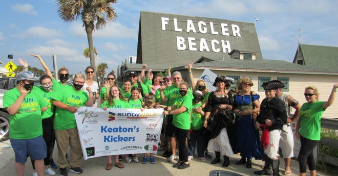 'Keaton's Kickers' gets a hand from the Krewe of the 13 along with supporters for the 15th Annual Buddy Walk to support the Fun Coast Down Syndrome Association.