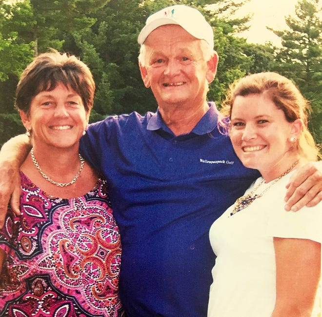 Bob Simons just recently put the finishing touches on his 50th year of coaching the varsity golf team at Paupack. He's pictured here with his beloved wife, Ann Marie, and their daughter Bridget.