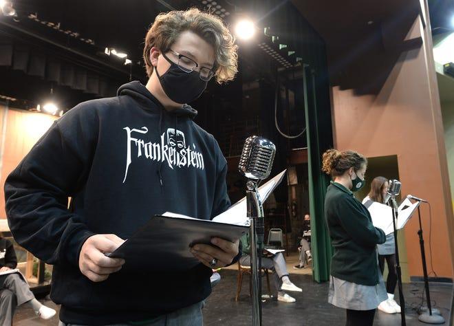 "Ben Kucharski, 17, plays Frankenstein in a rehearsal of Mercyhurst Preparatory School's radio theater-style production of ""Frankenstein."""
