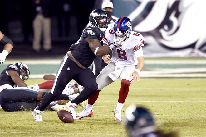 New York Giants quarterback Daniel Jones (8) fumbles after being hit by Philadelphia Eagle Brandon Graham during the second half of Thursday's game in Philadelphia.