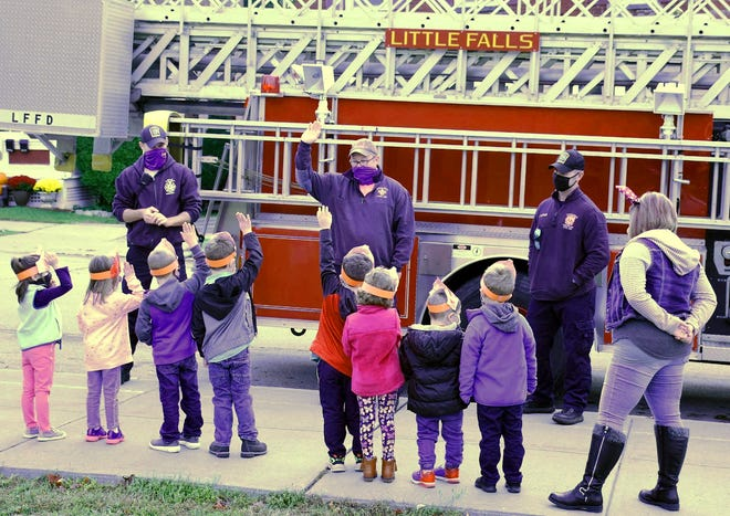 Little Falls firefighter Brian Dodge (center) asks for a show of hands from a Benton Hall Academy pre-kindergarten class while giving a presentation on fire safety Thursday morning.