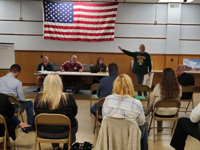 Human Calculator Scott Flansburg, standing, presents his Herkimer 9 vision for the village during a focus group meeting Wednesday at the Herkimer VFW.