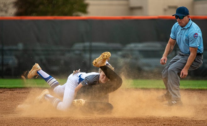 Grain Valley shortstop Emma Jane Ogle, top, holds onto the ball to tag out Platte County's Julianna Knudsen as they collide at second base on a throw from catcher Riley Downey in Thursday's Class 4 state quarterfinal. Grain Valley lost 3-1.