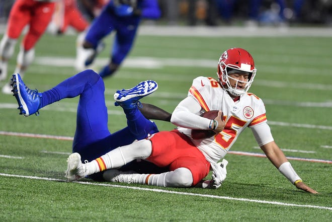 Kansas City Chiefs quarterback Patrick Mahomes, right, is sacked by Buffalo Bills' Mario Addison during Monday's game in Buffalo. The Broncos are concerned with slowing down the Super Bowl MVP in Sunday's game in Denver.