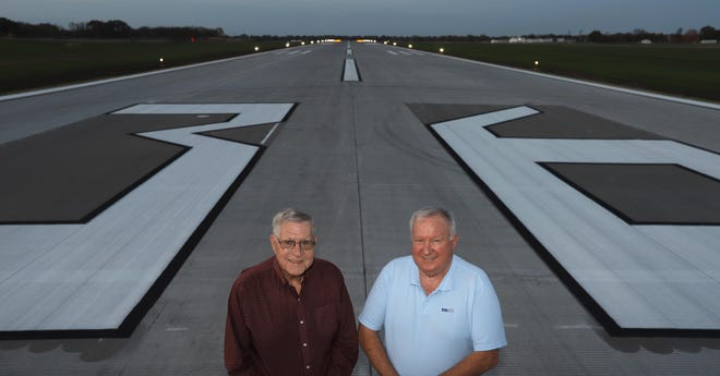 Southeast Iowa Regional Airport Authority board member Dan Wiedemeier and board chair Charlie Walsh Sr. are shown Friday at the south end of the newly completed 18-36 runway in Burlington. The $12 million runway improvement project also includes fixes to drainage and runway traffic that will be complete in December.