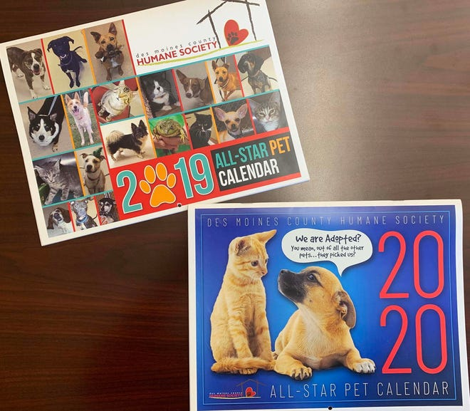 Des Moines County Humane Society past pet calendars are shown.