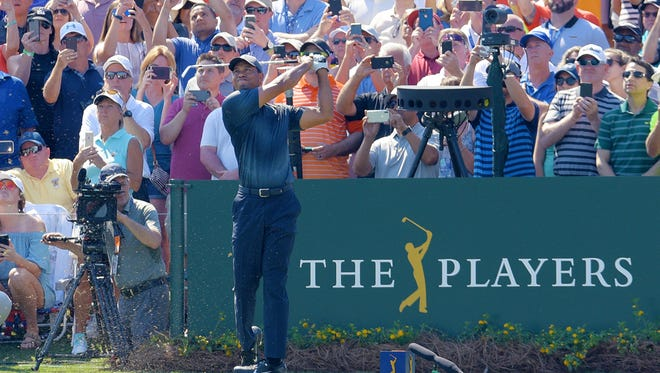 Tiger Woods tees off on the 17th hole during the 2018 Players Championship at the TPC Sawgrass Players Stadium Course. [Bob Self/Florida Times-Union]