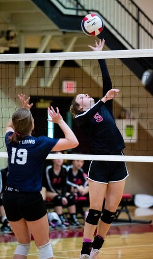 Texoma Christian's Annika Hogan attacks at the net against Weatherford Christian in district play at TCS.