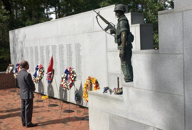 Rep. Greg Murphy (NC-03) stands in silent observance at the Beirut Memorial in the Lejeune Memorial Gardens on Oct. 23, the 37th anniversary of the terrorist attack on Marine barracks in Beirut, Lebanon.