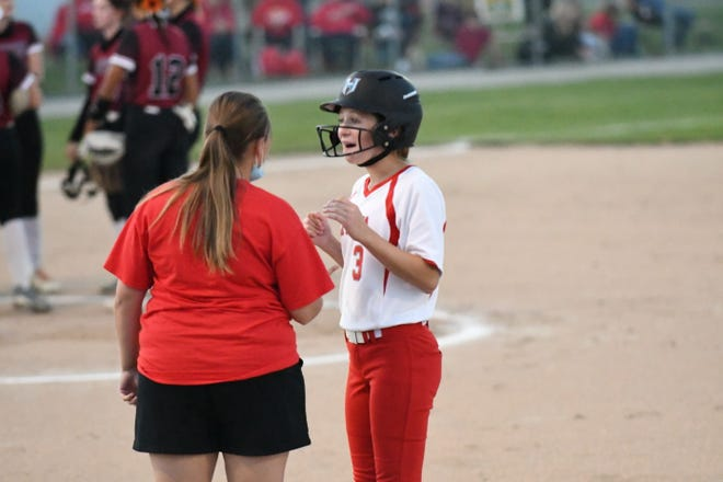 La Plata freshman Paige Carvajal reacts while talking to assistant coach Summer Wood after hitting a three-run double against Canton.