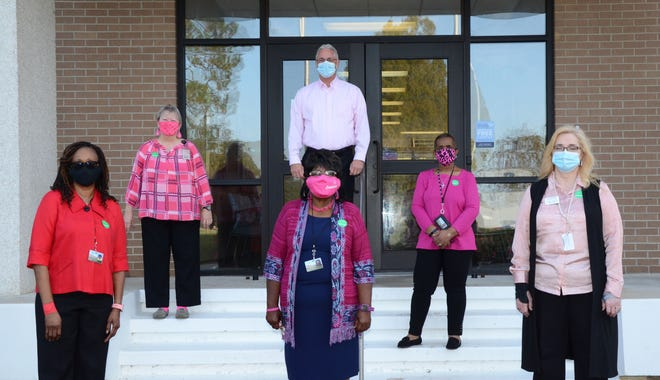 In celebration of Breast Cancer Awareness Month, Lenoir Community College President Rusty Hunt declared Oct. 21 Pink Day at the College. Pictured with Hunt (center) are, left to right, front row, cancer survivors Carolyn Anderson, Ann Plummer, and Charlene Meadows; back row, Susan Nobles and Shelia Wiggins. Not pictured are cancer survivors Susan Whitley and Robin Beaman. [CONTRIBUTED PHOTO]