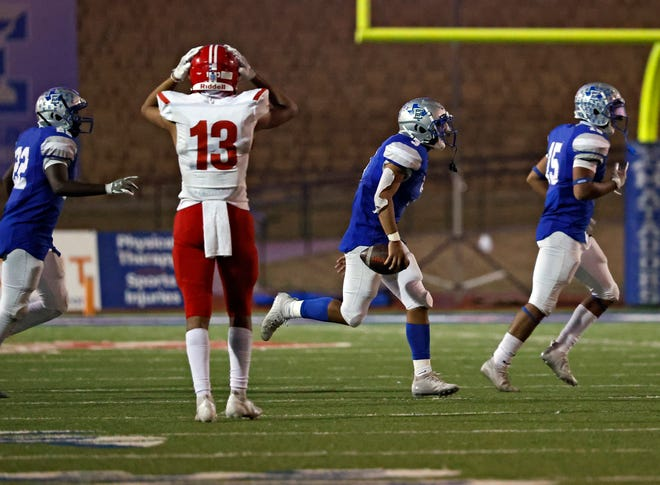 Raheim Ross (3) runs off the field after intercepting the ball to help Estacado defeat Perryton 26-20 in a District 2-4A Division II game Thursday at PlainsCapital Park at Lowrey Field.