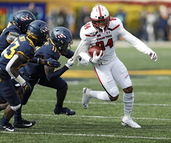 Texas Tech wide receiver Erik Ezukanma leads the Red Raiders with 21 catches for 295 yards. Ezukanma caught five passes for 74 yards in the Red Raiders' 38-17 victory last year at West Virginia.