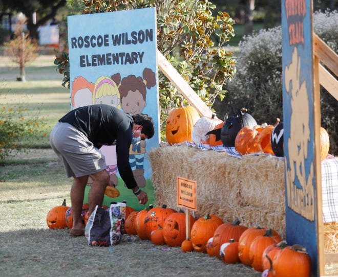 Texas Tech Accounting Major Andrew Canales lights pumpkins in the Roscoe Wilson Elementary display.  This is the 12th year that the Lubbock Parks and Recreation Department has held the annual Pumpkin Trail at the Lubbock Memorial Arboretum. The event started Thursday and will be open to the public at 6pm through Sunday. The event features 986 carved or painted pumpkins by citizens, local businesses and organizations.