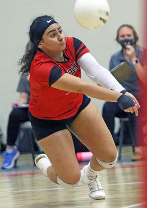 Victory Christian libero Jossy Rodriguez dives to make a dig against Leesburg First Academy on Thursday night in the Class 2A, Region 2 quarterfinals.