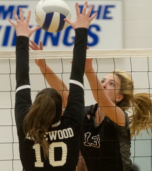 Lakeland Christian's Maxcy Chaney (13) and Edgewood's Carlise Helpling (10) battle at the net during Class 3A, Region 3 volleyball quarterfinals Thursday night at Lakeland Christian.