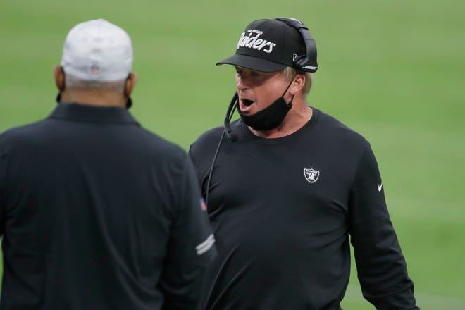 Las Vegas Raiders head coach Jon Gruden speaks on the sideline during a game against the Buffalo Bills on Oct. 4.