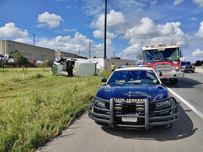 A semi-truck is flipped over on its side after a two-vehicle collision on Thursday near I-4.