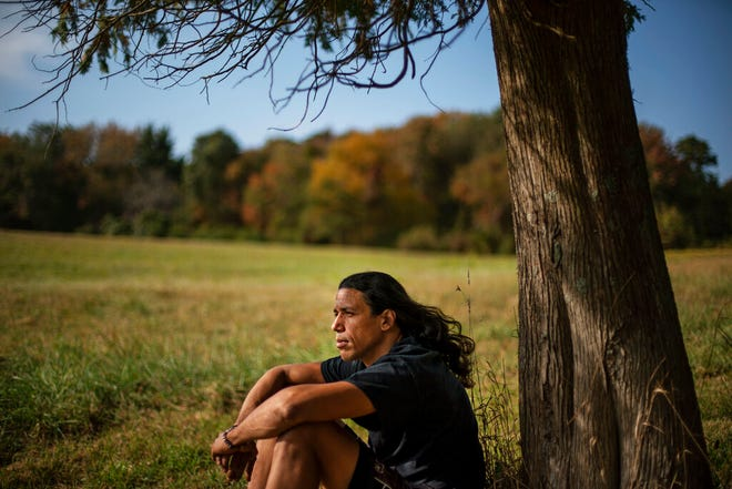 """Annawon Weeden, 46, a member of the Mashpee Wampanoag Tribe, sits for a portrait outside his home in Oakdale, Conn., Friday, Sept. 25, 2020. """"How do you pay somebody for that?"""" said Weeden when asked if governments should make financial reparations to Native people. """"The most valuable thing anyone can have or possess ever is time and you don't get that time back. I don't get my ancestors back. It's degrading to think that you could buy your way out of what you put us in. Actions speak for themselves,"""" Weeden said. """"You don't got to pay me a dime. Clean up your community, show some respect. Pay the land the respect. It's never about me. It's about this land. I'm only here for a short time. This land had to last a lot longer. Your children are going to have to inherit this. What do you want to leave them? Let's look about our children and how our children's lives are going to turn out because if we can't get things to go better for them, we've all failed."""""""