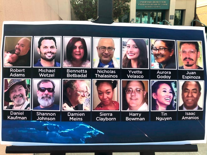 Photos of the 14 victims killed in a 2015 terror attack in San Bernardino, Calif., are displayed outside federal court in Riverside, Calif., on Friday. Enrique Marquez Jr. was sentenced to 20 years in prison Friday for supplying the rifles used by his friend Syed Rizwan Farook and Farook's wife to open fire on a meeting and holiday gathering of San Bernardino County employees who worked with Farook. After killing 14 people and wounding 22, Farook and his wife were killed in a gun battle with authorities.