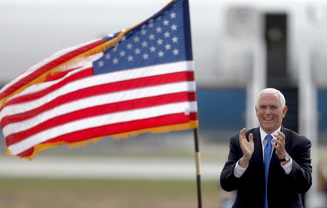 """Vice President Mike Pence arrives for a """"Make America Great Again Victory Rally"""" at Grand Aire in Swanton, Ohio, on Friday."""
