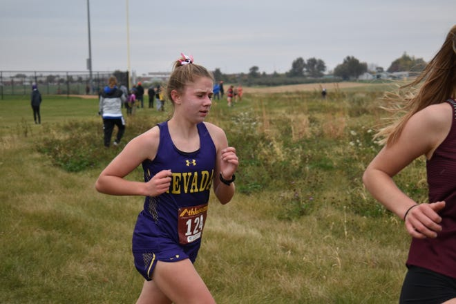 Nevada freshman Tori Meinecke competes in the girls' race at the Class 3A state qualifying cross country meet in Pella Oct. 21. Meinerts placed 14th to qualify for state.